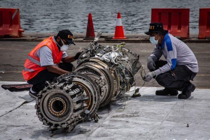 Investigators inspecting Lion Air wreckage