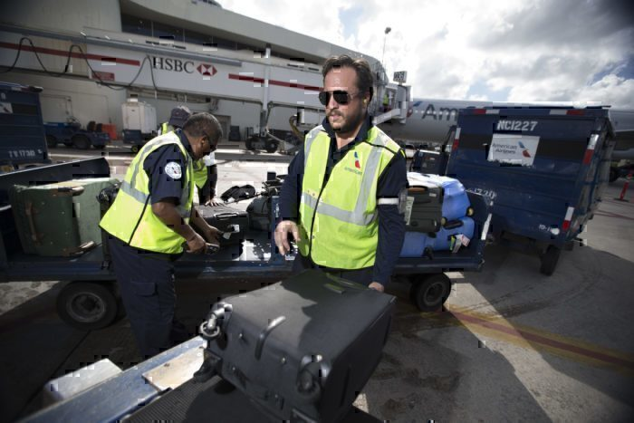 American Airlines crew loading baggage in the cargo