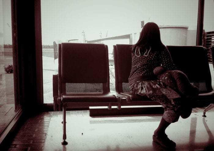Teen waiting at airport