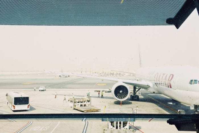 Qatar Airways aircraft parked at gate