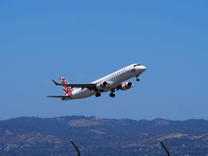 Virgin Atlantic airplane over mountains