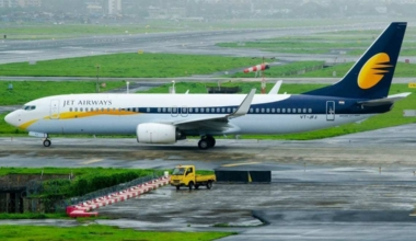 Jet Airways airliner sits on airport apron