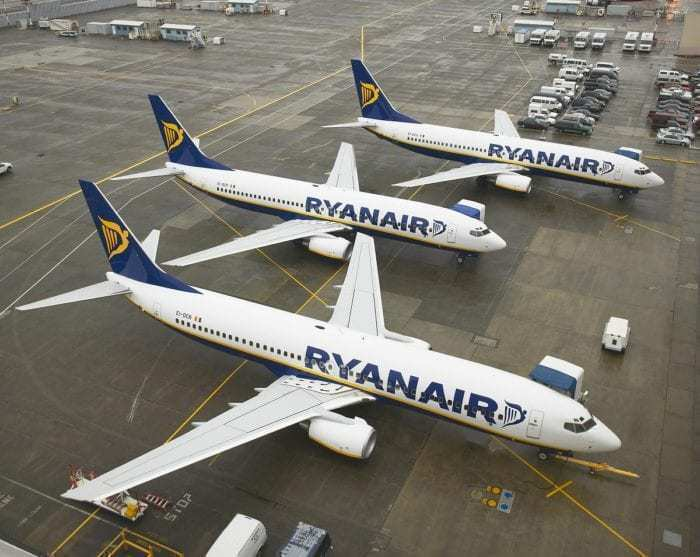 3 Ryanair airlines on apron of airport