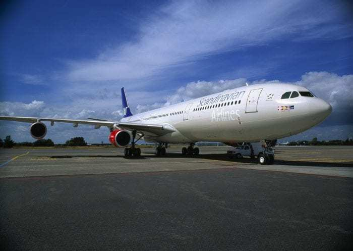 SAS airliner on airport apron