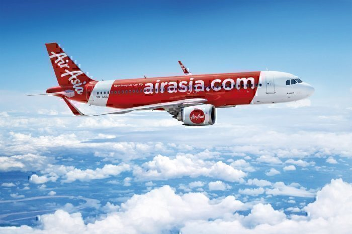Air Asia concept plane above cloud