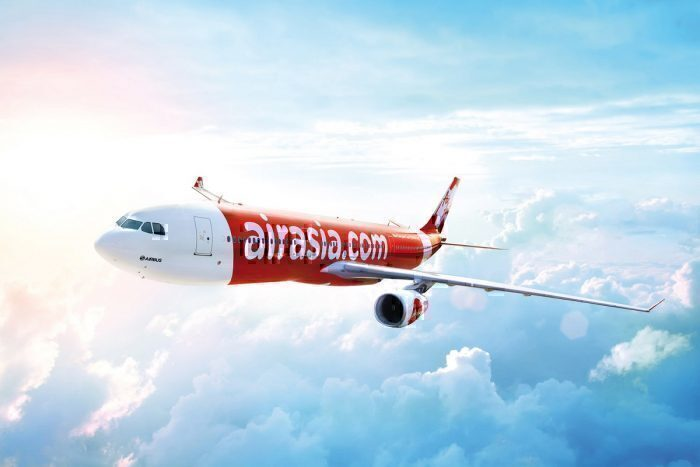 AirAsia concept plane above clouds