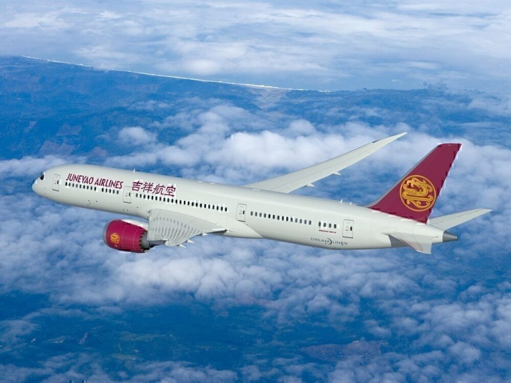 Juneyao Airlines in flight above coast