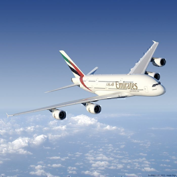 Emirates A380 flying above clouds
