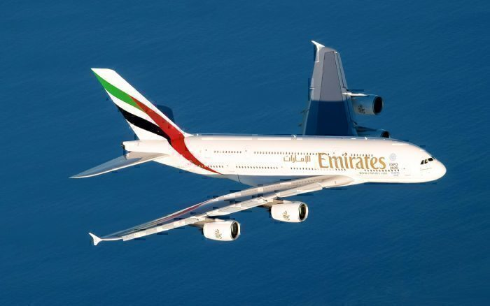 Emirates A380 flying above water