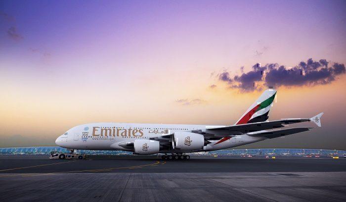 Emirates A380 on ground in dusky sky