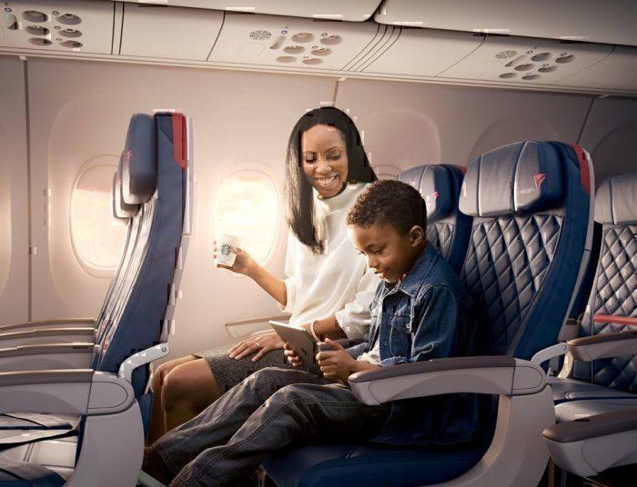 child on deltta flight with tablet