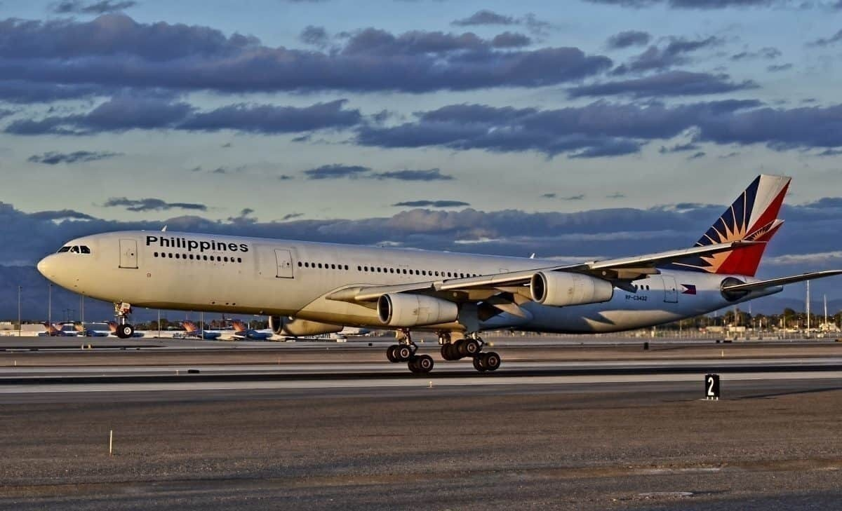 Philippine Airlines A340-313X RP-C3432 at dusk or dawn, photographer's golden hours