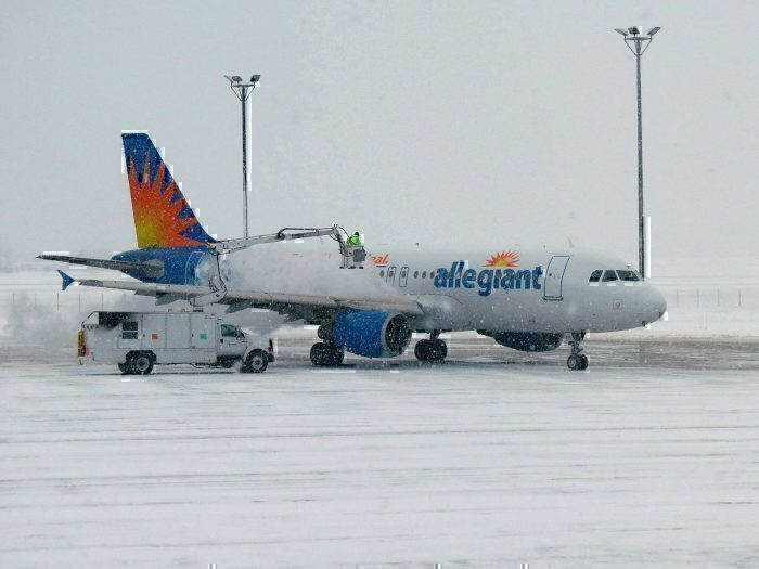 Allegiant airliner in snow on taxiway