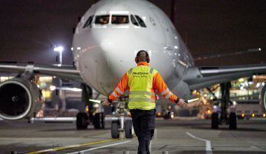 Heathrow Airport marshal in action