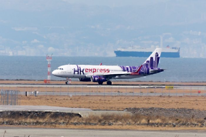 An HK Express jet on the runway at Hong Kong