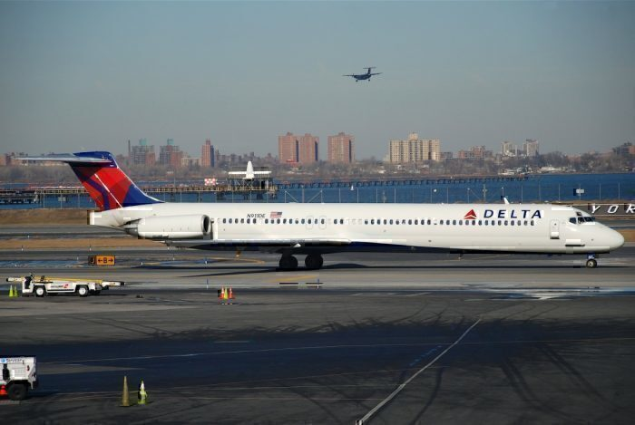 A Delta MD-88 on the runway