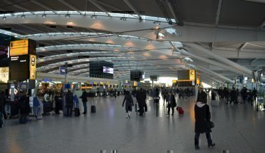 A busy airport terminal with passengers