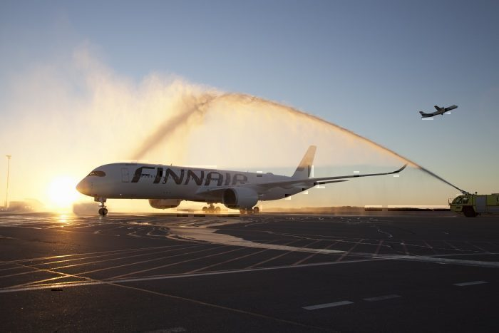 Finnair airliner on taxiway in dusk