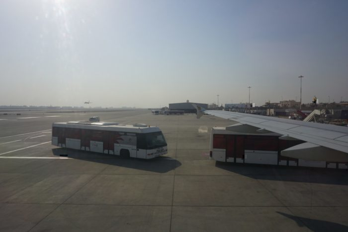 Buses waiting next to the plane