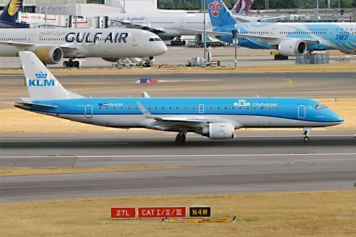KLM Cityhopper, PH-EXV, Embraer ERJ-190STD with a Gulf Air Boeing 787 Dreamliner in the background