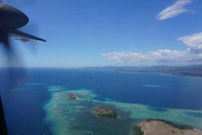 Coral atolls, blue ocean