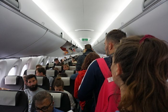 plane aisle, boarding
