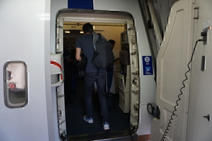 boarding, entering plane
