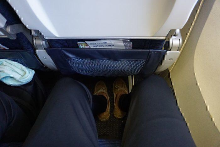 premium economy leg room, leg room