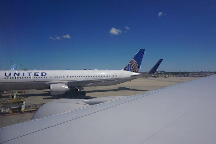 parked plane, next to 757, landing