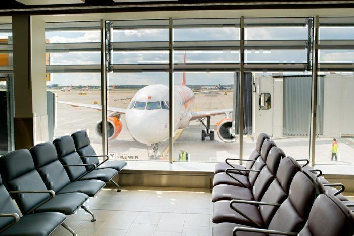 Empty boarding lounge and easyjet aeroplane