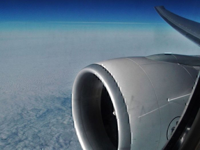 GE90 jet engine from aircraft window in flight
