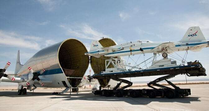 Crews unload Orion spacecraft from NASA's Super Guppy