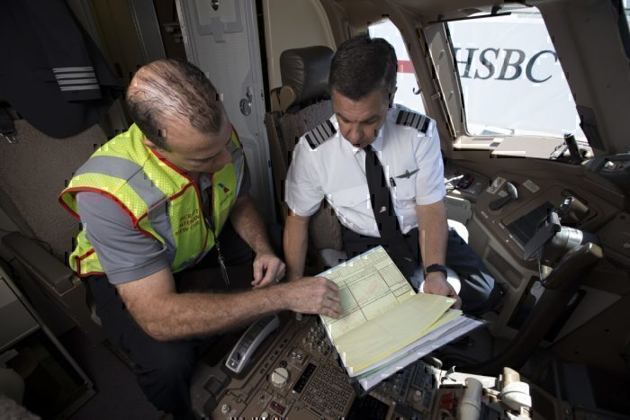 AA airline staff reviewing data