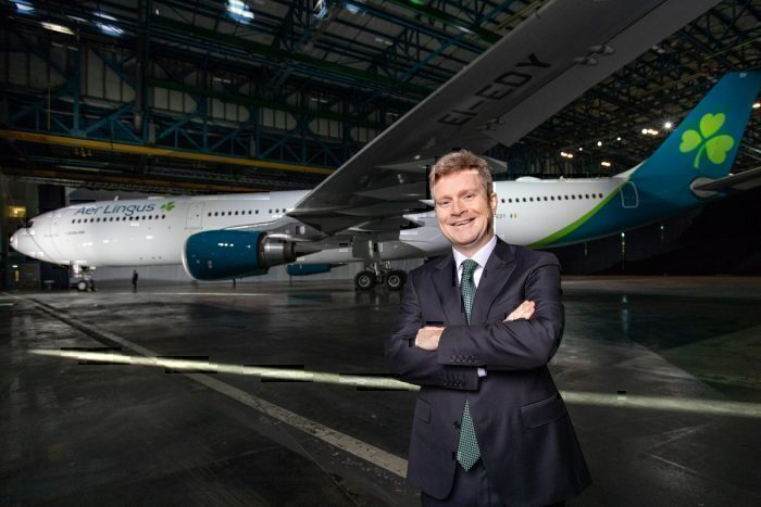 Aer Lingus boss with jet in background