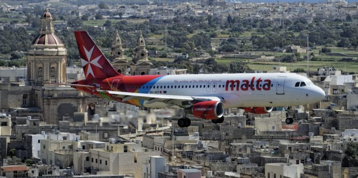 Air Malta Aircraft Over City
