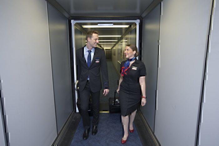 Two flight attendants walking the bridge