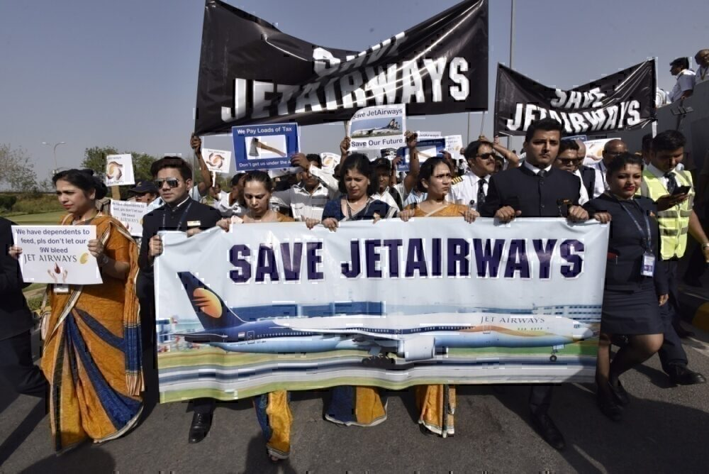 Jet Airways' employees protest outside IGI Airport over delay in their salaries, on April 13, 2019 in New Delhi, India. (Photo by Sanjeev Verma/Hindustan Times via Getty Images)