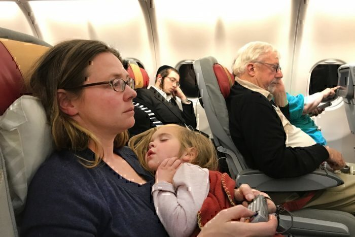Mother and daughter on aircraft