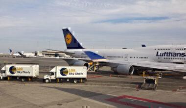 Lufthansa aircraft behind LSG Catering Trucks