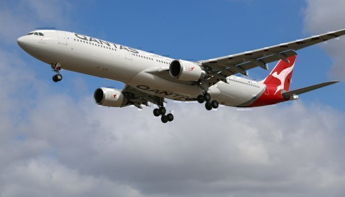 Qantas Sydney to Perth flight evacuated via slides after smoke fills cabin