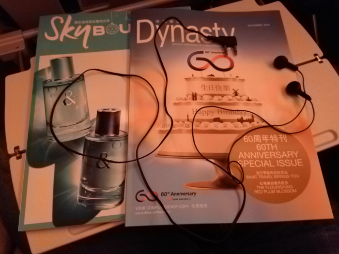 China Airlines magazine and headphones laid out on the tray table