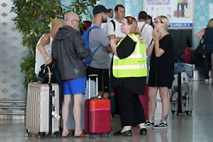 Travel disruption at airport, staff helper
