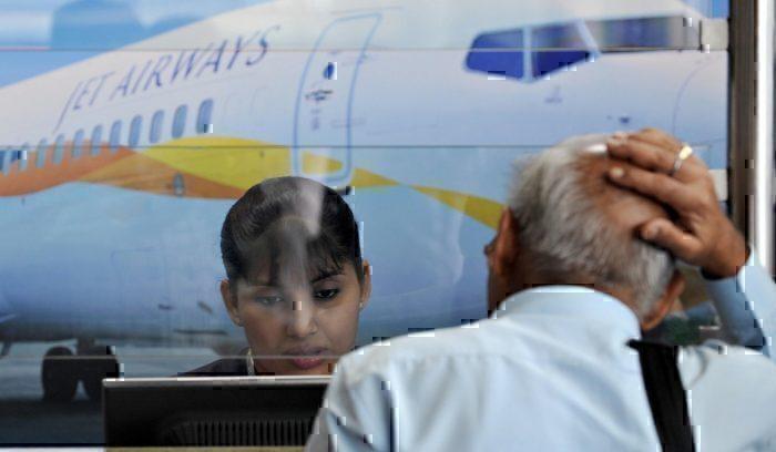 Passengers reacting at Jet Airwasy counter