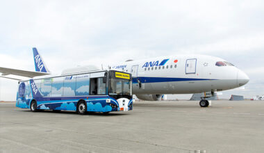 ANA, electric autonomous bus next to aircraft