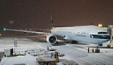 Cathay Pacific Boeing 777-367ER in snow