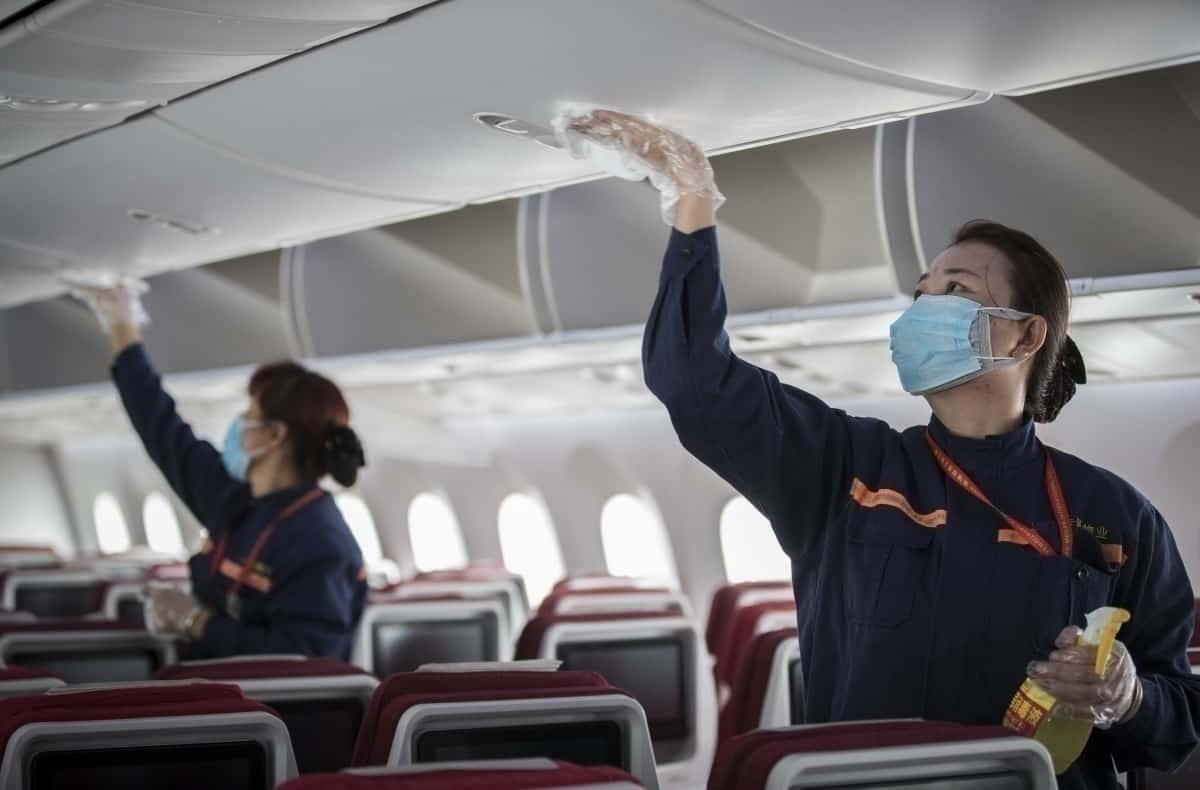 Cabin crew disinfect aircraft