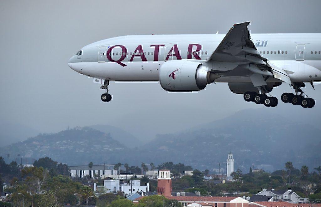 Qatar Airways flying over Doha