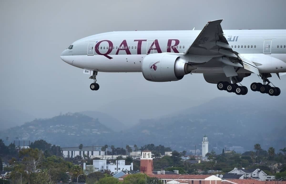 Qatar Airways flying over Doha