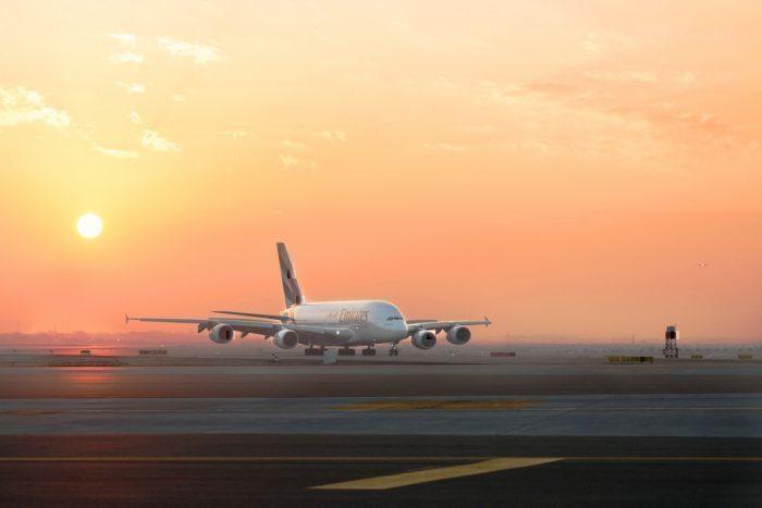 Emirates aircraft with sunset