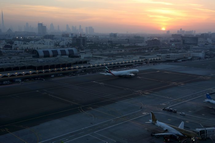 Dubai airport with sunset and city in the background